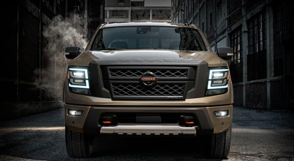 A brown 2021 Nissan Titan is shown from the front in an alley while preparing for a Nissan end of lease.