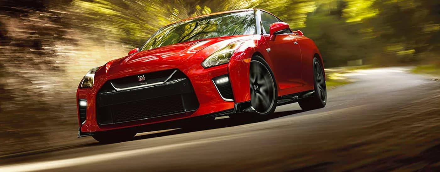 A red 2021 Nissan GT-R is shown from a low angle rounding a corner.