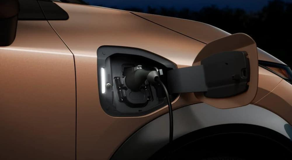 The charging port of a 2022 Nissan Ariya, the new Nissan EV, is shown.