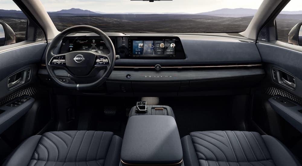 The black interior of a 2022 Nissan Ariya is shown.