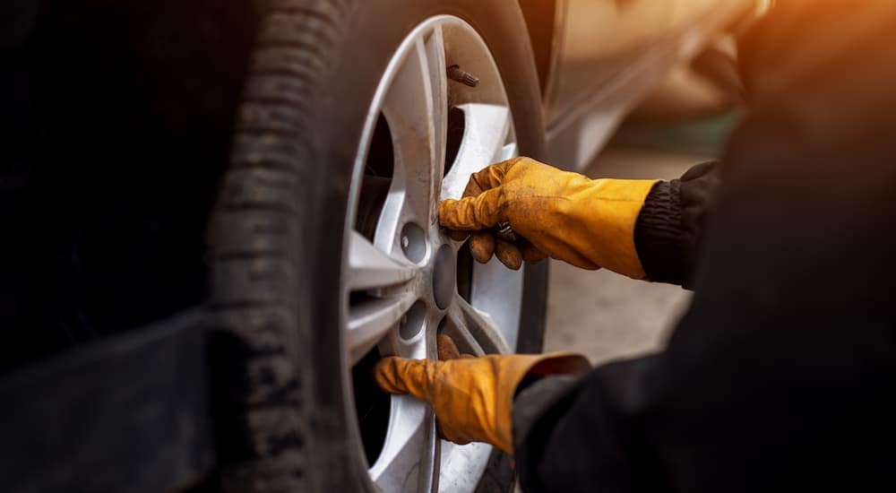 A gloved mechanic is changing a tire during a service at  a Chicagoland tire shop.