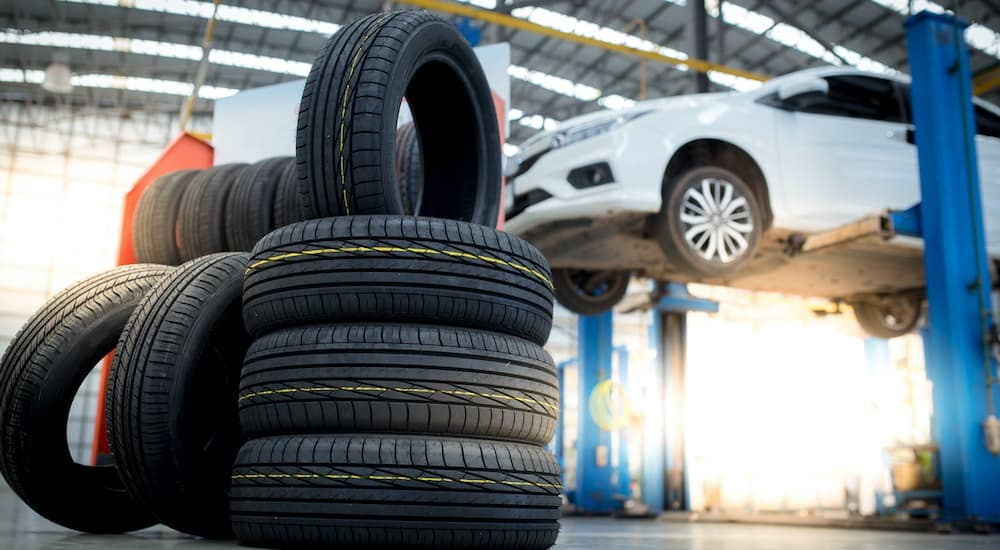 A stack of tires is shown in a repair shop.
