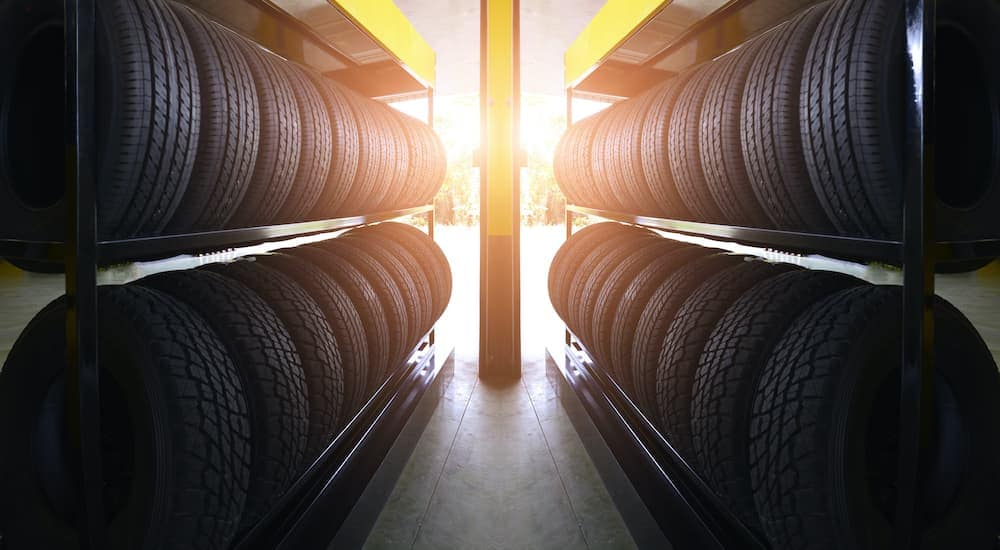 Four rows of tires are waiting to be sold at Chicagoland tire shop.