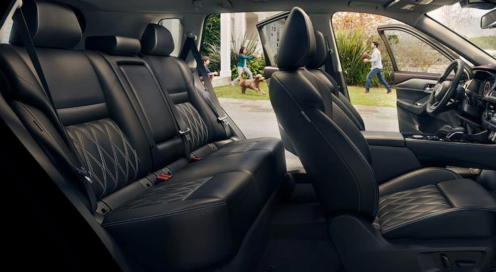 The interior of a 2021 Nisan Rogue shows two rows of seating.
