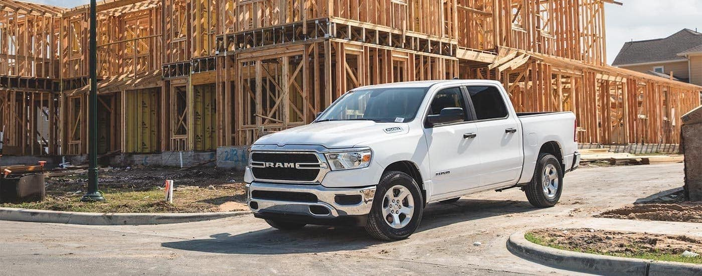 A white 2020 Ram 1500 from a Ram dealer near me is parked at a construction site near Florence, KY.
