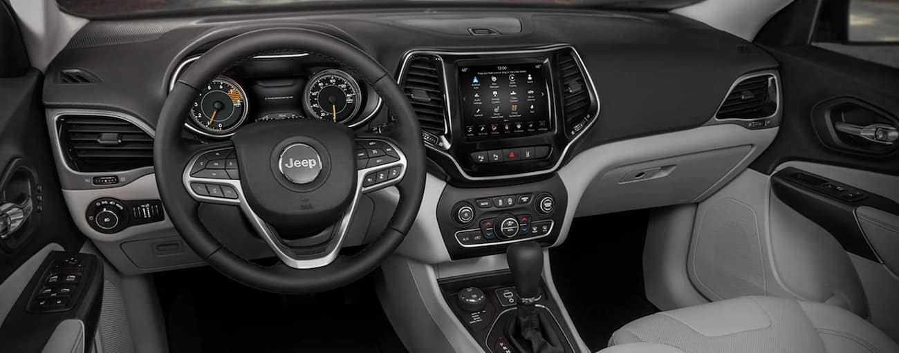 The dashboard and screen are shown in a 2021 Jeep Cherokee.
