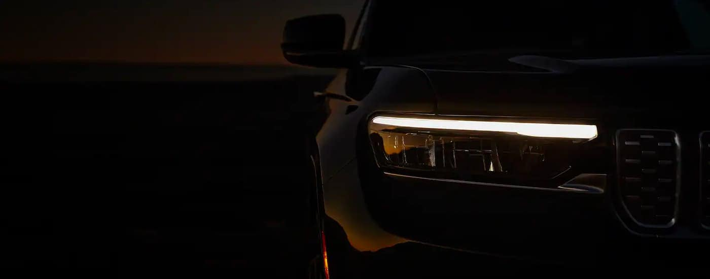 The LED DRL is shown illuminated in the dark on a 2021 Jeep Grand Cherokee L.