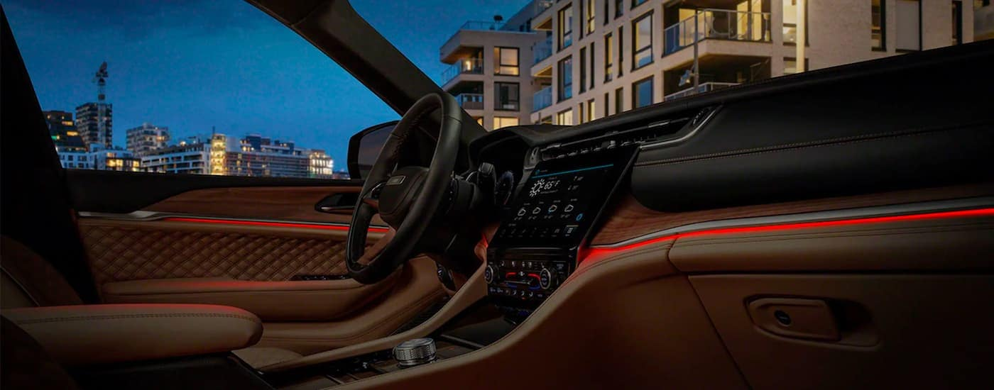 The interior and accent lighting is shown in a 2021 Jeep Grand Cherokee L.