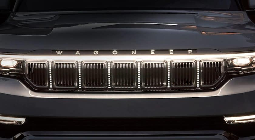 The grille of a dark grey 2022 Wagoneer is shown in closeup.